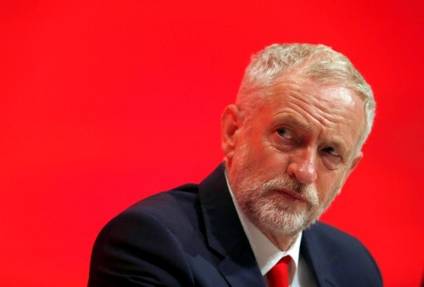 Leader of Britain's Labour Party, Jeremy Corbyn listens to a speech on the first day of the Labour Party conference, in Liverpool