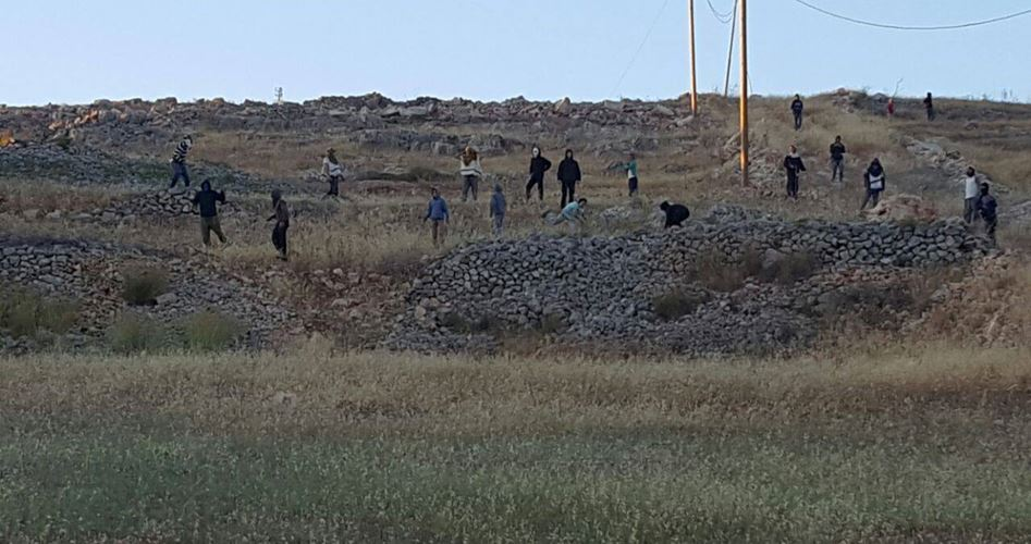 Settlers on Palestinian land